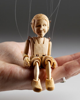 The smallest Pinocchio marionette in the world - precisely hand-carved from a linden wood